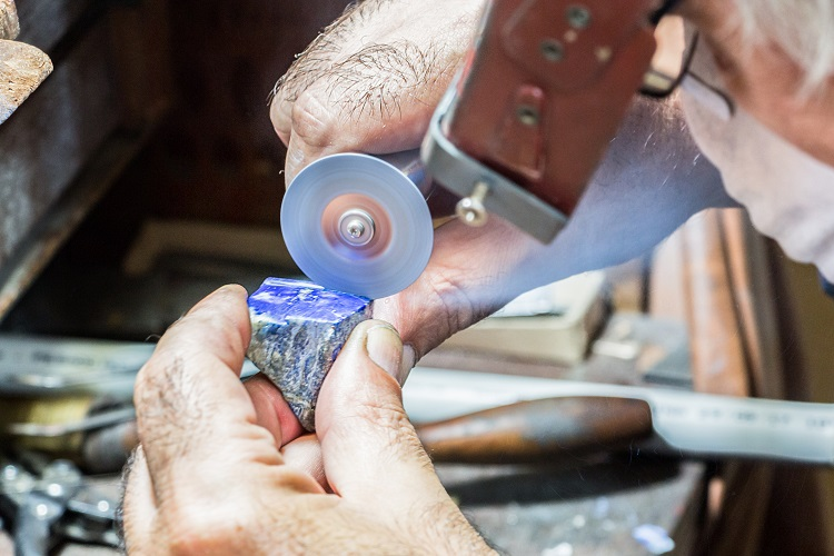 Jeweler Cutting Gemstone